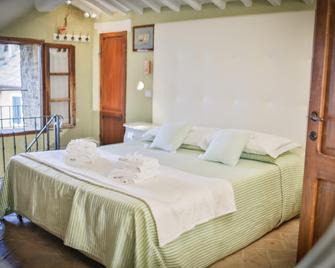 Hotel Palazzo Del Capitano Wellness & Relais - Historic Luxury Capitano Collection - San Quirico d'Orcia - Bedroom