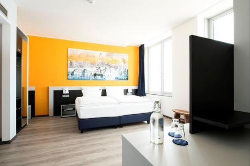 carathotel Düsseldorf City - Düsseldorf - Bedroom