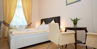 Hotel Am Schloss - פרנקפורט אם מיין - חדר שינה