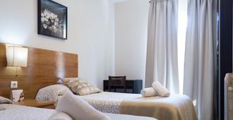 Hostal Alogar - ברצלונה - חדר שינה