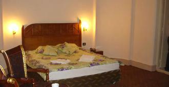 Cairo Center Hotel - Cairo - Slaapkamer