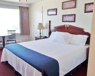 Americas Best Value Port Polson Inn - Polson - Спальня