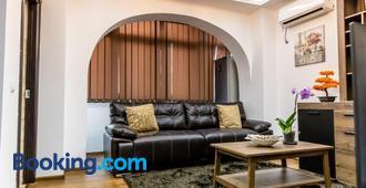 Sud Dreams Apartments - Bucharest - Living room