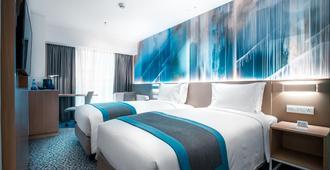 ฮอลิเดย์อินน์เอ็กซ์เพรส มะนิลา นิวพอร์ตซิตี้ - เครือโรงแรมไอเอชจี - ปาเซย์ - ห้องนอน