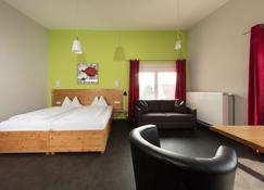 德姆林酒店-咖啡廳 - 維爾茨堡 - 臥室