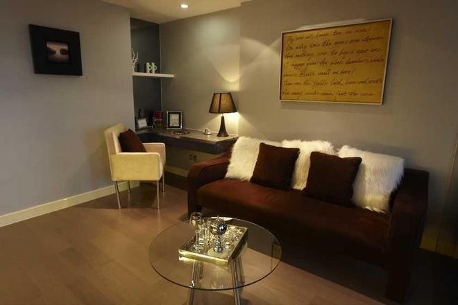 Q-city Hotel - Guangzhou - Living room