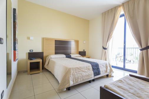 Ticho's Hotel - Castellaneta - Schlafzimmer