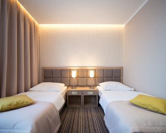 Hotel Almarco - Сьрода-Великопольська - Спальня