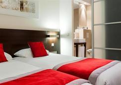 Kyriad Prestige Strasbourg Nord - Schiltigheim - Schiltigheim - Bedroom