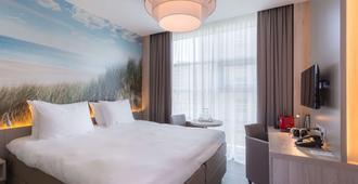 Ramada by Wyndham The Hague Scheveningen - האג - חדר שינה