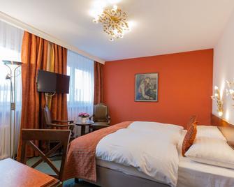 Athmos Hotel - Ла Шо-де-Фон - Спальня