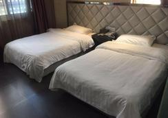 Outai Business Fast Hotel Nanjing Lukou International Airport - Нанкин - Спальня