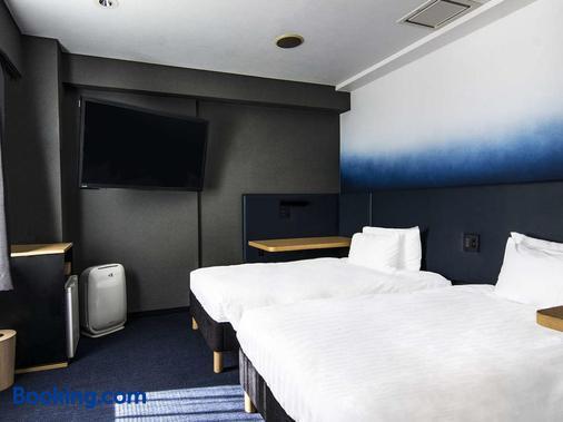 Hotel New Shohei - Tokyo - Phòng ngủ