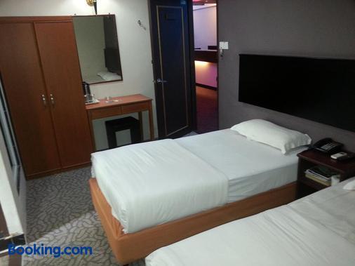 Oriental Inn - Kuching - Phòng ngủ