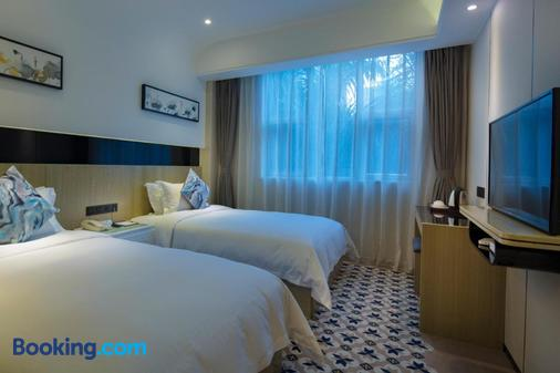 Paco Business Hotel Tiyuxilu Metrobranch - Guangzhou - Bedroom
