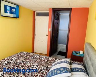 Hostal Rosita Latacunga - Латакунга - Bedroom