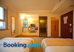 Tian Long Hotel - Jiaoxi - Bedroom