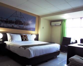 OYO 2487 Sampurna Jaya Hotel - Tanjung Pinang - Bedroom