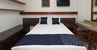 هوتل ديل باسيو - بويبلا - غرفة نوم