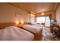 Hotel Nagashima - Kuwana - Slaapkamer