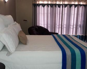 Alimop Lodge Inn Bed and Breakfast - Midrand - Bedroom