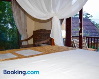 Ubud Sawah Homestay - Тегаллаланг - Спальня