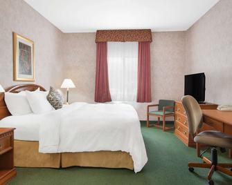 Days Inn & Suites by Wyndham Dumas - Dumas - Bedroom