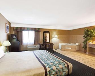 Days Inn & Suites by Wyndham Artesia - Artesia - Ložnice