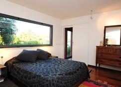 Eco Suites Resort - Сантьяго-ду-Касен - Спальня