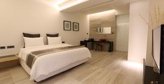 Tongzhan Design Inn - Tainan - Soverom