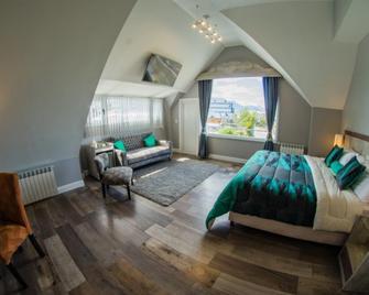 Hostería América - Ushuaia - Bedroom