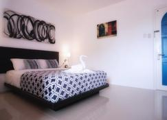 D' Gecko Hotel - Moalboal - Bedroom