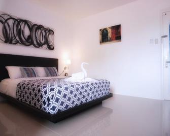 D' Gecko Hotel - Moalboal - Schlafzimmer