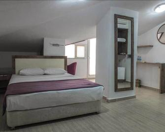 우디 호텔 - 차낙칼레 - 침실