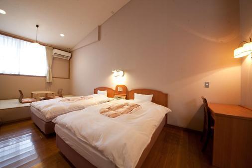 Yufuin Yawaraginosato Yadoya - Yufu - Bedroom