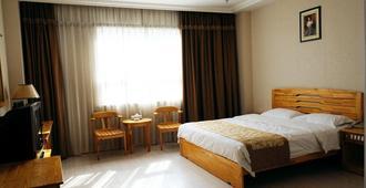 青島利客來商務酒店 - 青島 - 臥室