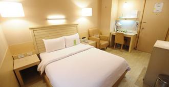Kindness Hotel Liouhe Night Market Zhongzhen - קאושיונג - חדר שינה