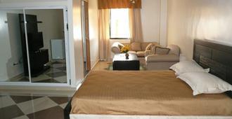 Apartahotel Roma II - Santo Domingo - Bedroom