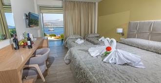 Paradise Lost Hotel-Apartments - Tolo - Bedroom