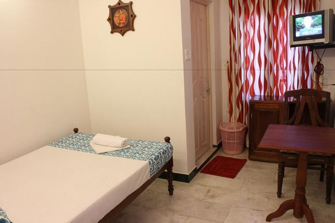 白玫瑰飯店 - 科欽 - 臥室