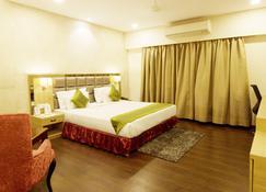 Treebo Tryst Kc Manor - Jamshedpur - Camera da letto