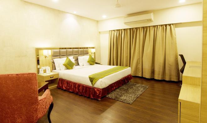 Treebo Tryst Kc Manor - Jamshedpur - Bedroom