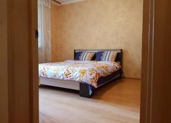 Deluxe Apartment Grina 34-1 - Moscú - Habitación