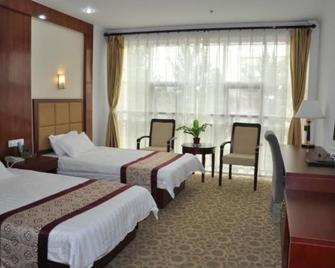 Qingdao Jiaonan Shuangzhu Blue Harbour Hotel - Poli - Bedroom