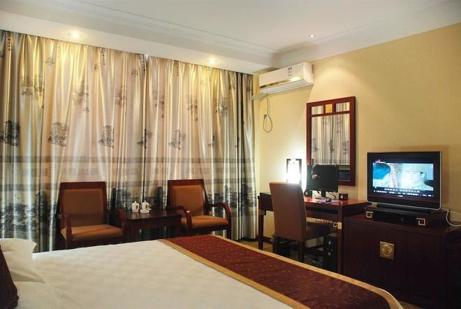 Wuyue Scenic Area Hotel Wuyuan - Ziyang - Schlafzimmer