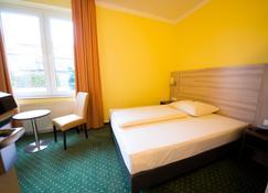 幻境酒店 - 杜伊斯堡 - 臥室