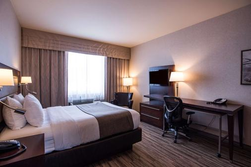 Quality Inn & Suites - Val-d'Or - Bedroom
