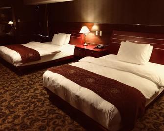 King Ambassador Hotel Kumagaya - Kumagaya - Schlafzimmer