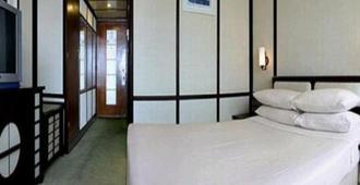 Shenzhen Empire Hotel - שנג'ן - חדר שינה
