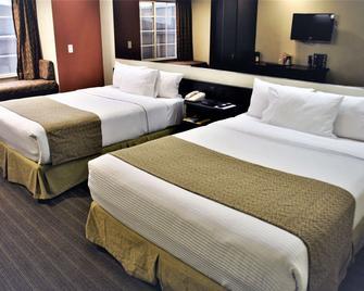 Microtel Inn & Suites by Wyndham Toluca - Toluca - Bedroom